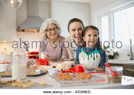 Three generation family baking cookies during Christmas - Stock Photo