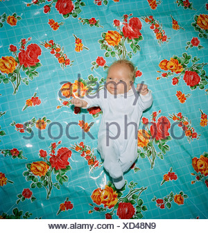 A baby lying on a blanket Stockholm Sweden. - Stock Photo