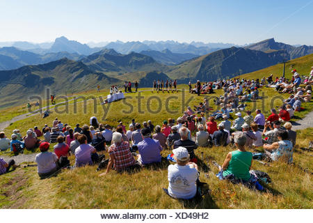 Mountain mass during a meeting of alphorn players, Diedamskopf, Schoppernau, Bregenzerwald, Bregenzer Wald, Vorarlberg, Austria - Stock Photo