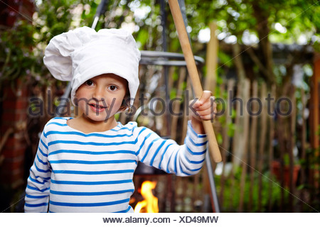Little Girl Wearing Chef's Hat - Stock Photo