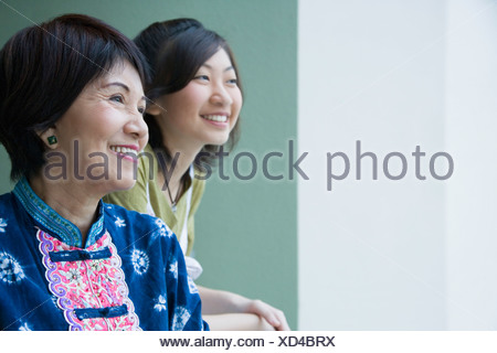 Close-up of a senior woman smiling with her granddaughter Stock Photo