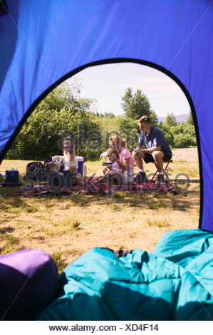 Family relaxing at a campsite - Stock Photo