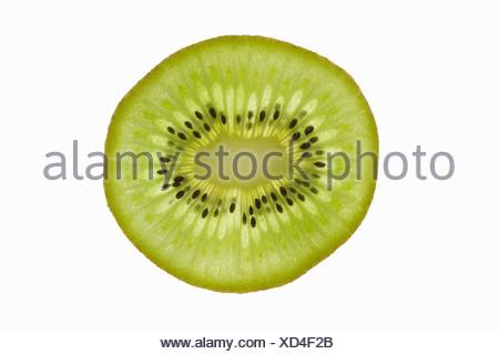 A slice of kiwi fruit (backlit) - - Stock Photo