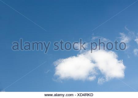 White Fluffy Cloud Against Blue Sky - Stock Photo