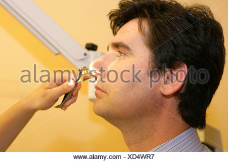 ENT physician man examination - Stock Photo