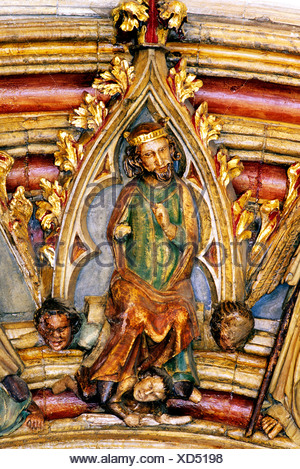 Norwich Cathedral cloisters, door to South Aisle, St. Edmund, 14th century painted medieval stone carving, carvings Saxon King - Stock Photo