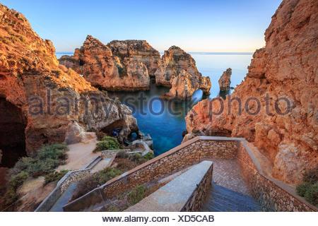 Soft colors of dawn on the red cliffs of Ponta da Piedade Lagos Algarve Portugal Europe - Stock Photo