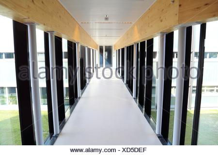 Hallway with transparent walls on a sunny day - Stock Photo