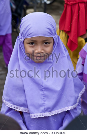 Young Muslim girl dressed in traditional school clothing at a school in Mataram, Lombok Island, Lesser Sunda Islands, Indonesia - Stock Photo