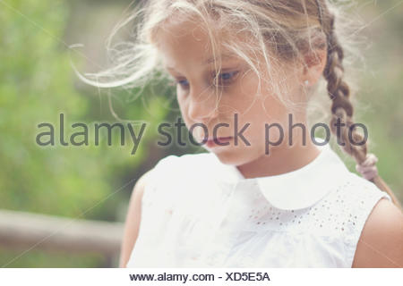 Portrait of a girl looking pensive - Stock Photo