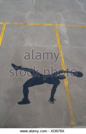 Shadow of basketball player jumping - Stock Photo