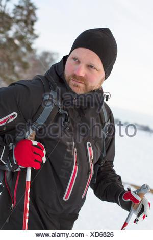 Sweden, Stockholm, Alvsjo, Man preparing for nordic walking - Stock Photo