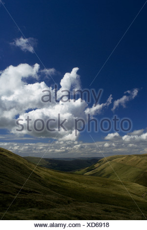 Upland landscape under blue sky and clouds - Stock Photo