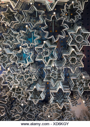 Germany, Munich, View of variety of cookie cutters in shape of christmas star - Stock Photo