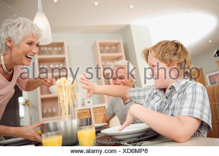 Family having lunch together - Stock Photo