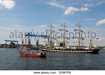 Russian Tall Ship, Kruzenshtern, and other tall ships in front of the crane of the Howaldtswerke-Deutsche Werft, HDW Shipyard, - Stock Photo