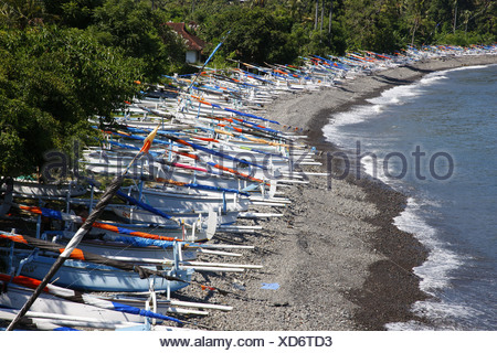 Outrigger boats in Selang, coastal road, south-east Bali, Republic of Indonesia, Southeast Asia - Stock Photo