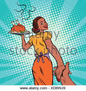 follow me African-American housewife with roast Turkey - Stock Photo