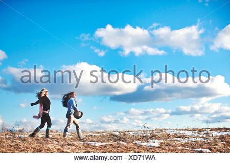 Two mature women enjoying exhilarating walk - Stock Photo