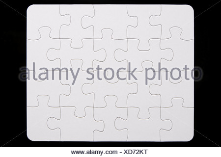 Close-Up Of Small Puzzle - Stock Photo