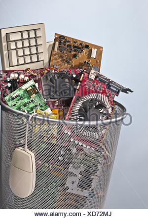 Paper basket full of electronic waste - Stock Photo