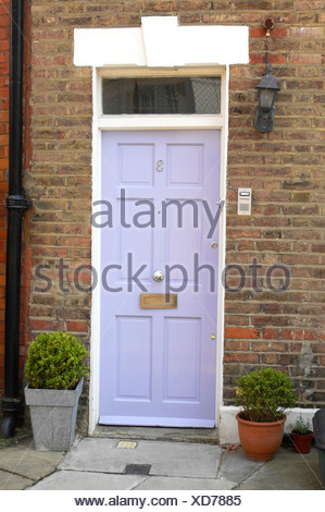Mauve Front Door With Two Pot Plants Either Side Stock Photo