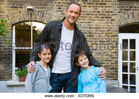 Portrait of a father and his children - Stock Photo