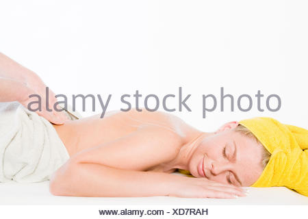Wellness girl series massage lower back - Stock Photo