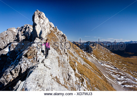 Climber on Bepi Zac climbing route in San Pellegrino Valley above San Pellegrino Pass, overlooking the Bervagabunden Hut - Stock Photo