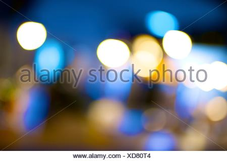 background created with blurred lights of a pub. - Stock Photo