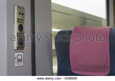 Train compartment, seat, sockets, nobody, trajectory carriage, train, compartment, inside, pillows, connections, computer connection, connection, train journey, travelling, moving, on the way, mobile, window, - Stock Photo
