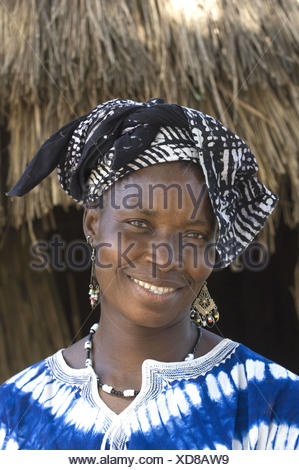 Portrait, woman, headscarf, smile, steelworks, Saloum delta, Senegal, - Stock Photo