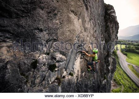 Climber lead climbing on a rock face, Martinswand, Zirl, Tyrol, Austria - Stock Photo