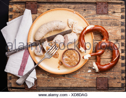 Bavarian snack with weisswurst white sausages and pretzel - Stock Photo