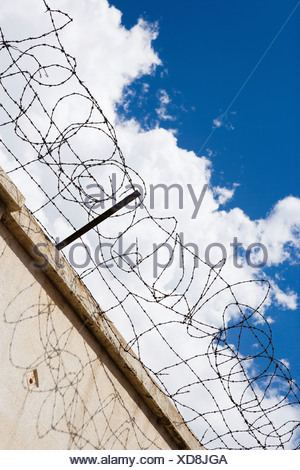 Barbed wire fence against sky - Stock Photo