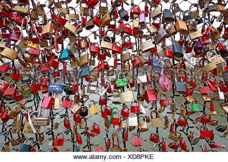 Large Group Of Padlocks On Chain Link Fence - Stock Photo
