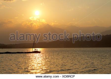 Sailing boats at Lake Millstatt during sunset, Carinthia, Austria - Stock Photo
