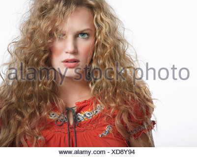 Portrait of serious young blonde woman - Stock Photo