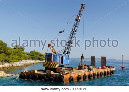Dredger in operation at deepening a shipping channel, Pazman Island, Dalmatia, Adriatic, Croatia, Europe - Stock Photo
