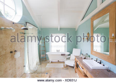 Bathtub and shower in rustic bathroom - Stock Photo