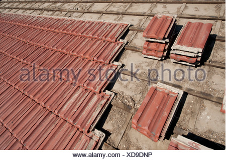 Salvaged roof tiles being removed from a roof in Lincoln, NE. - Stock Photo