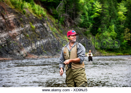 Fly fishers in Margaree River, Cape Breton Island, Nova Scotia - Stock Photo
