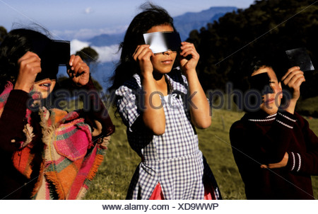 Children Watching Eclipse - Stock Photo