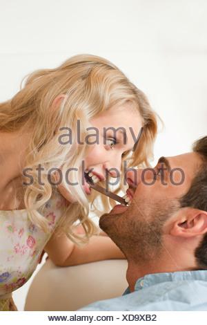 Couple eating chocolate - Stock Photo