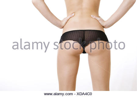 Woman, body, slim, briefs, standing, back view, detail, buttom, legs, model released, - Stock Photo