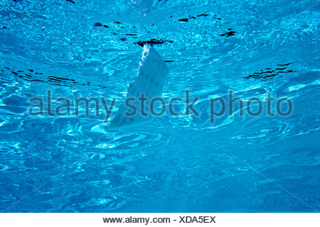 An obscure object in a swimming pool - Stock Photo