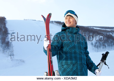 Young people going for skiing - Stock Photo