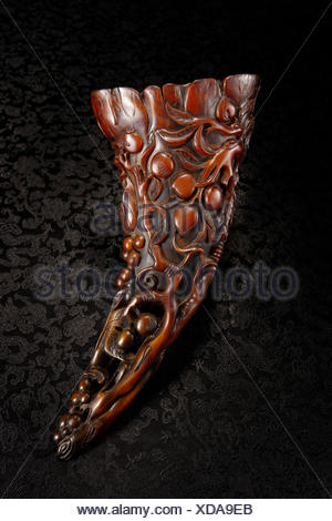 Rhino horn cup carved grape fruit regrettable - Stock Photo