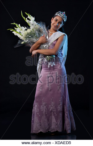 Teenage beauty queen with a bouquet - Stock Photo