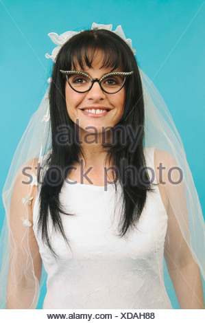 A bride wearing funny glasses - Stock Photo
